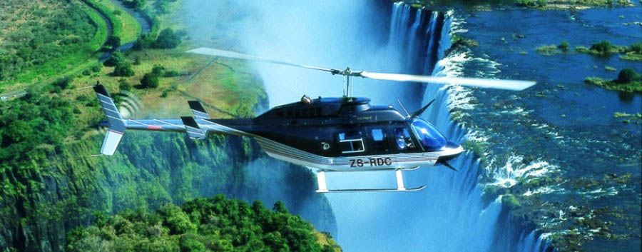 Zimbabwe, triangolo d'acqua - Zimbabwe Helicopter Flying over The Victoria Falls