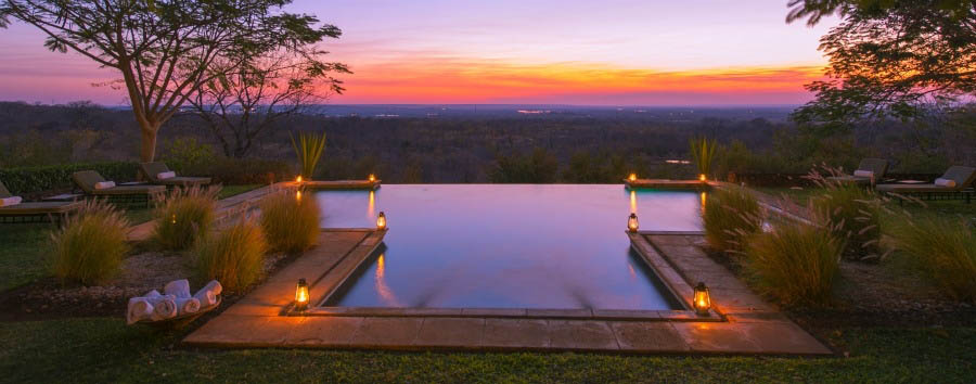Stanley Safari Lodge - Pool view at sunset