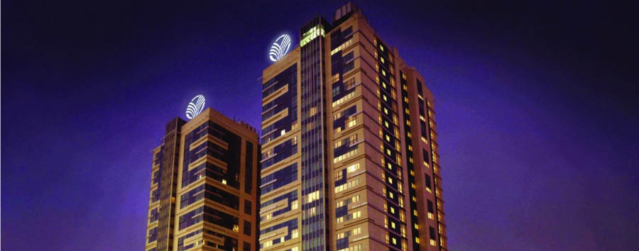 Media Rotana - Hotel Exterior by night