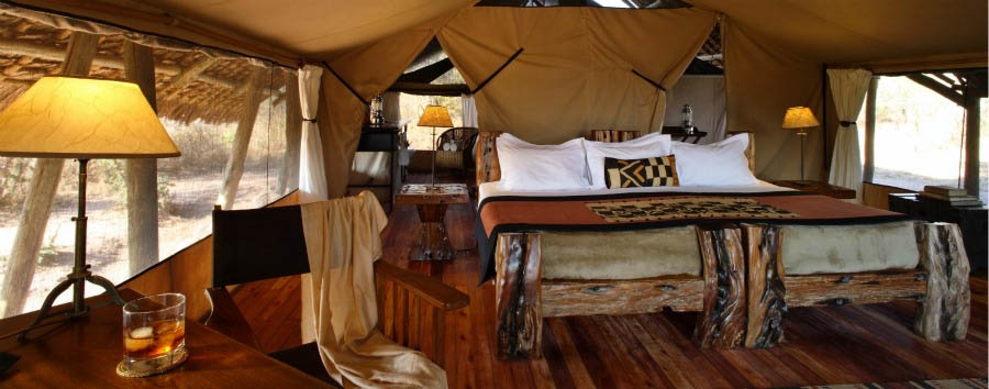 Jongomero Camp - Bedroom with elegant dhow wood furniture