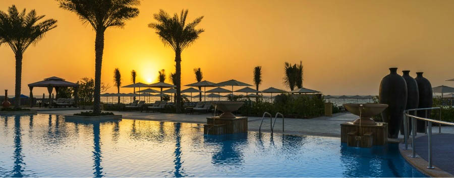 Ajman+Saray%2C+a+Luxury+Collection%C2%AE+Resort+-+Pool+Area+at+Sunset
