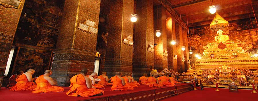 Bangkok City Break - Bangkok Buddha image and monks in Wat Pho Temple © MJ Prototype