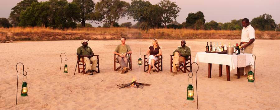 Luwi Bush Camp - Sundowners in the Luwi River