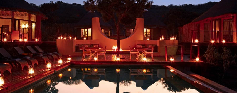 Thanda+Tented+Camp+-+Pool+Area+by+night