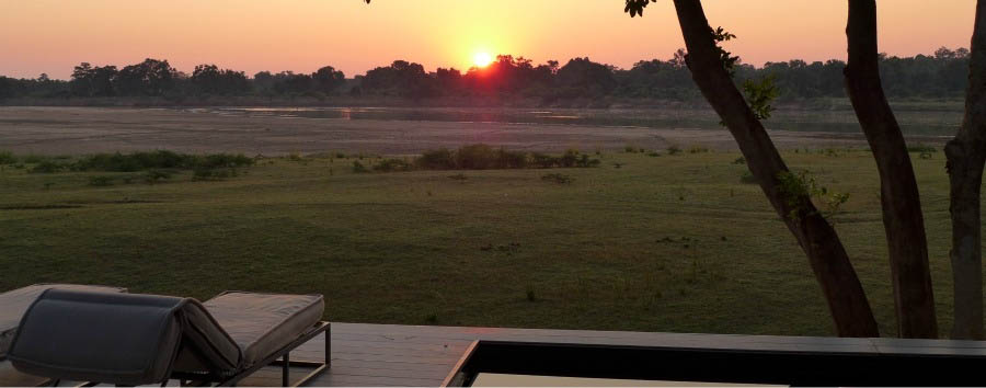 Chinzombo Lodge - Sunset view from the pool area