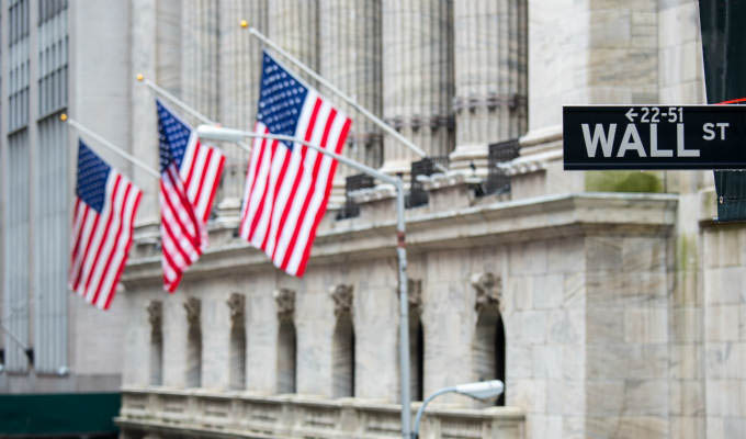 Wall street sign with New York Stock Exchange background © vichie81/Shutterstock - New York