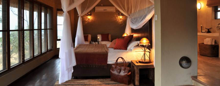 Ngoma Safari Lodge - Suite & Bathroom