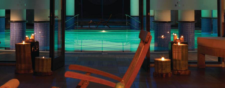 Kempinski Barbaros Bay - Indoor pool by night