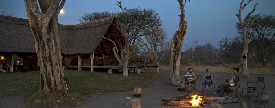 Bomani+Tented+Lodge+-+Sundowners+at+Camp+Fire