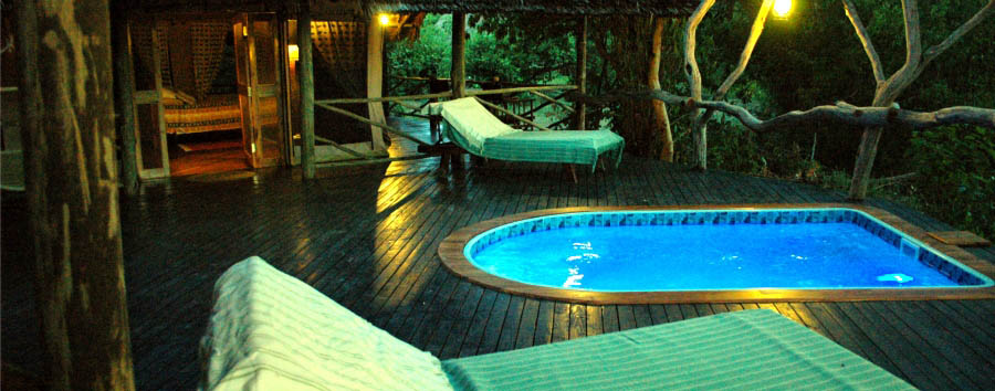 Rufiji River Camp - Pool suite in the evening