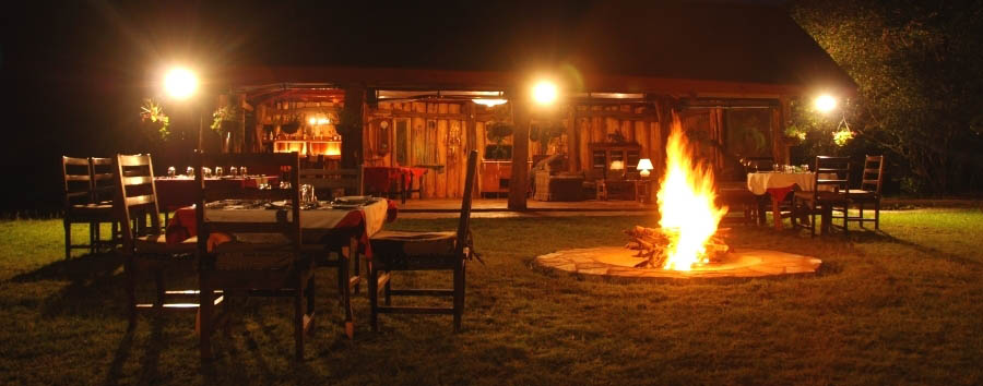 Royal Mara Safari Lodge - Dinner at the boma fireplace