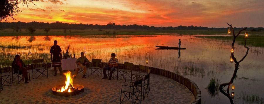 Botswana - Sanctuary Chief's Camp, Boma Fire at Sunset