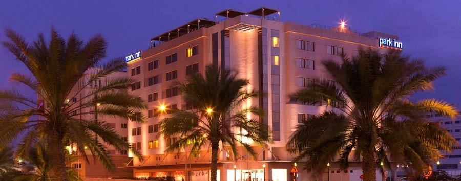 Park Inn Hotel Muscat - Hotel Exterior by night